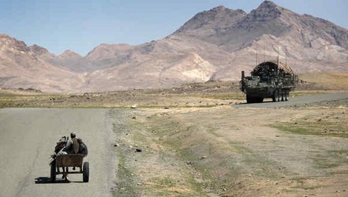 A cart and Stryker armored personnel carrier near Shah-Wali-Kot