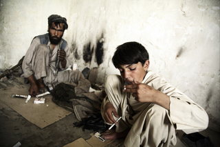 Child and adult heroin users in Afghanistan.jpg