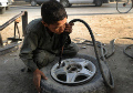 Feature: Extreme poverty drives Afghan children to work in odd jobs