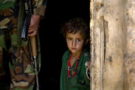 Children in Afghanistan live in the shadow of gun