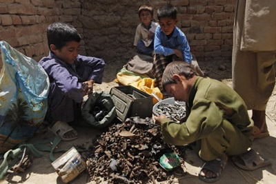 Afghan children with unexploded ordnance