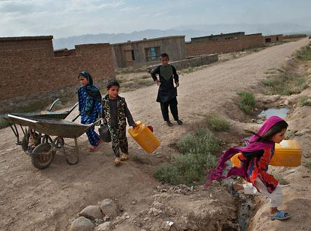 Alice-Ghan lacks running water, so children go several times a day to fetch water in jugs