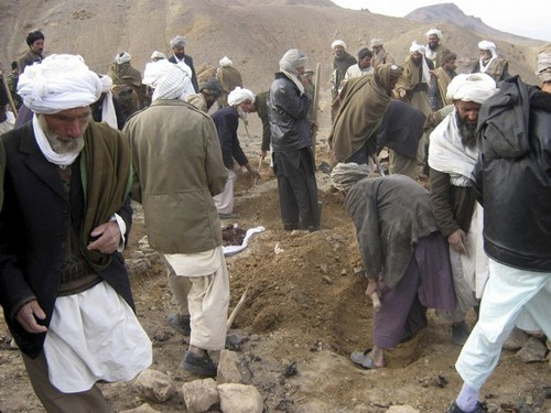 Afghans dig graves for the victims