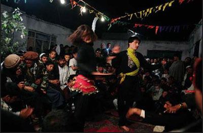 Afghan dancing boys in a gathering