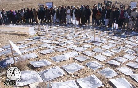 Family members of the victims brought photos of their loved ones and placed them on what might be the mass graves of the martyrs