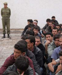 Iranian guard watches over Afghan refugees awaiting deportation in May