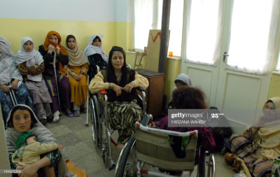 Disabled Afghan women gather in a waiting room of an International Committee of the Red Cross (ICRC) hospital in Kabul, 15 November 2006