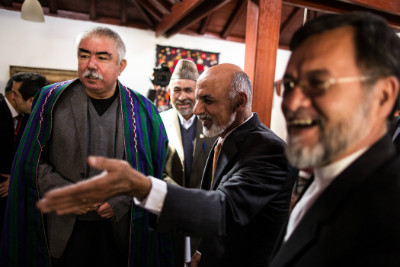 Ashraf Ghani, center, greeted his nominee for first vice president, Abdul Rashid Dostum, left, in April 2014