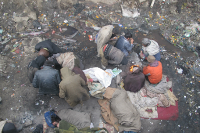 Drug addicts gather under a bridge in Kabul, where they sleep through cold nights and inject and snort drugs by day