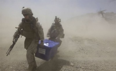 US marines carry box full of ballots