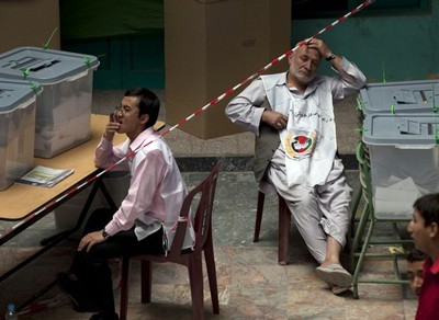 Election workers in empty polling station