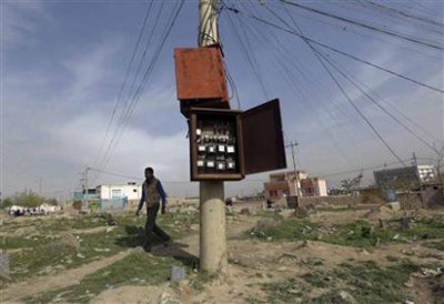 A man walks past electricity meters in Kabul April 15, 2013