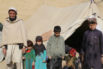 Amir Jan with his children by their tent in Samar Khel, a camp outside Jalalabad where people displaced by war have taken shelter