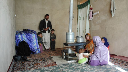The father of this Afghan household is a laborer, and in debt
