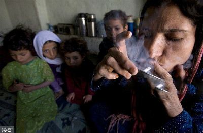 Female drug user with children in Afghanistan