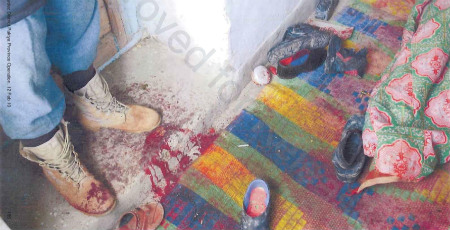 A photograph taken by military investigators in the room where members of an Afghan family were killed near Gardez in Afghanistan's Paktia province
