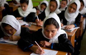 Afghan girls attend a class