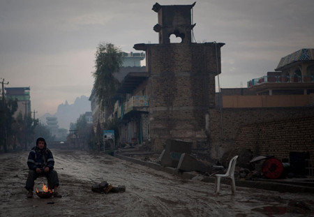 a private security guard watches a sensitive neighborhood in Kandahar, Afghanistan