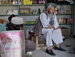 hopkeeper Habib Noor, who said he was among dozens of people arrested by U.S. special operations forces following a roadside bombing, sits in his shop in Maidan Shahr, Wardak province
