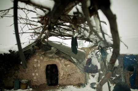 Some people have been in the camps for as long as seven years; others arrived in the past year. In the Charahi Qambar camp, 13 people live in this one-room hut