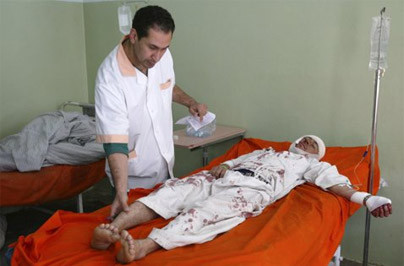 An Afghan man receives treatment at a hospital after an explosion in Herat province November 12, 2011