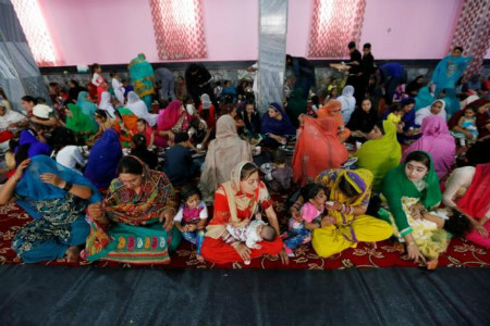 Afghan Hindu and Sikh families wait for lunch inside a Gurudwara, or a Sikh temple, during a religious ceremony in Kabul, Afghanistan