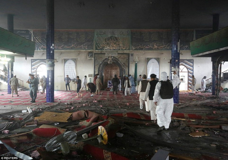 The battered interior of the mosque is laid bare as Afghan worshipers begin the lengthy clean-up operation in the wake of the attack