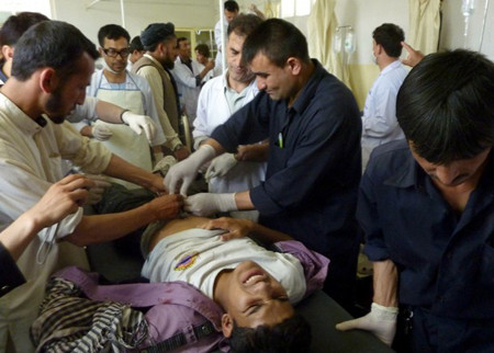 A wounded Afghan boy receives treatment at a hospital after a protest in Taloqan May 18, 2011