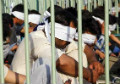 Iranian police put Afghan refugees inside cages, on public display