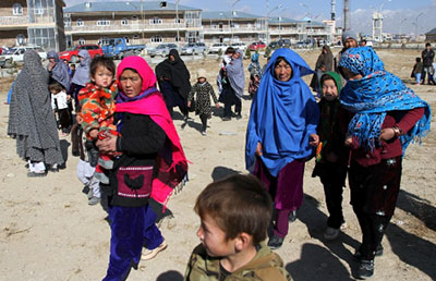 Afghan families fleeing from the districts of Malistan and Jaghori, because of the conflict between Taliban and Afghan forces, arrive in Ghazni, Afghanistan
