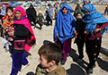 "Thousands flee as Taliban attack Afghanistan's ""safe"" districts"