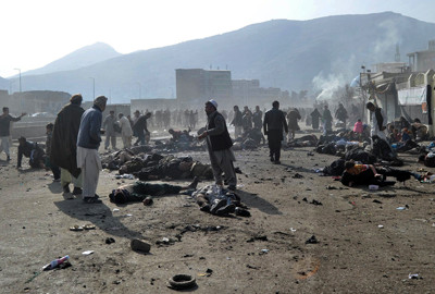 Afghans run from an explosion during a religious ceremony in Kabul city center