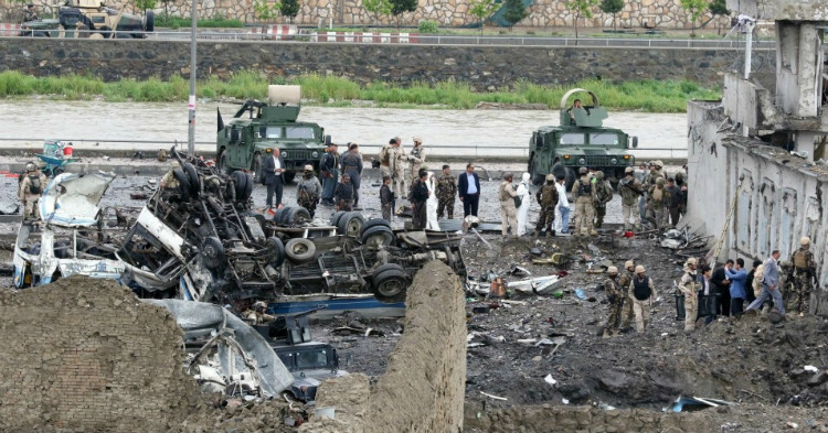 Afghan security officials at the site of the Kabul blast that killed and wounded hundreds