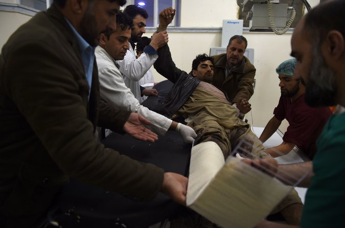 A man being treated after the explosion rocked the center of Kabul