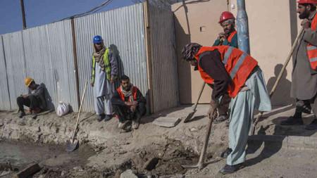 Afghan laborers work on a roads project last month in Kabul