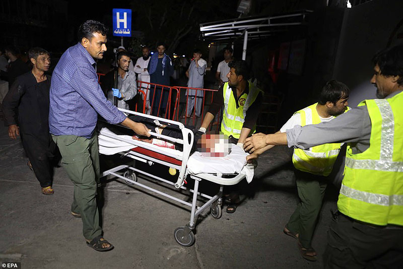 Suicide bomber kills 63 and wounds 182 in bloody attack on packed wedding reception in Kabul