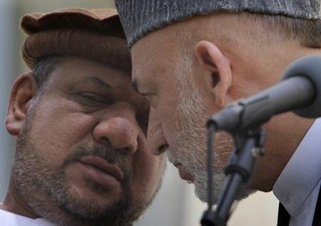 Hamid Karzai talking to Qaseem Faheem, a brutal warlord