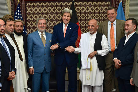U.S. Secretary of State John Kerry shakes hands with Afghan presidential candidates Abdullah Abdullah and Ashraf Ghani after a press conference in Kabul, Afghanistan
