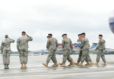 A U.S. Army carry team transfers the remains of Army Cpl. Kevin W. White, of Westfield, N.Y.