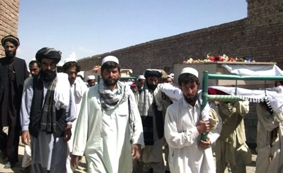 Afghans carry bodies of four people killed by NATO