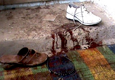 Blood is seen near the footwear and a hairband inside a room
