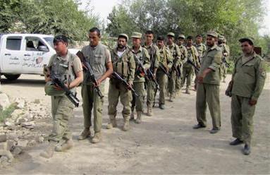 >Members of the Afghan Local Police prepare for a foot patrol in Kunduz province, Afghanistan