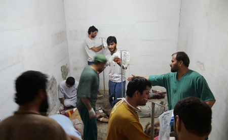MSF staff treat injured colleagues and patients in the hospital safe room after the airstrike