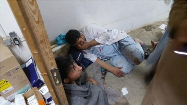 These MSF staff appear to be in shock following airstrike attack by US forces Kunduz Afghanistan