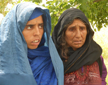 Lal Bibi with her mother in Kunduz, Afghanistan. She is a rape victim
