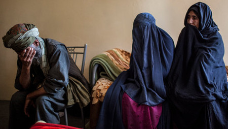 Lal Bibi, a rape victim, with her parents in Kunduz, Afghanistan