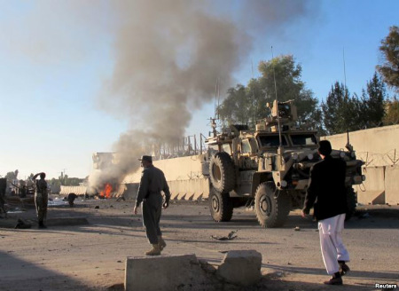 Smoke bellows after a suicide car bomb blast attacked a military convoy in Lashkar Gah, Helmand province