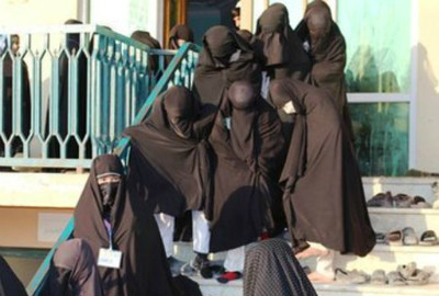 Female students in full body veil at the Ashraf-ul Madares madrassa, an unregistered religious school in northern Kunduz province