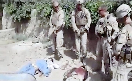 An image from a video posted on the Internet shows Marines standing around corpses in Afghanistan. The video shows them urinating on the bodies