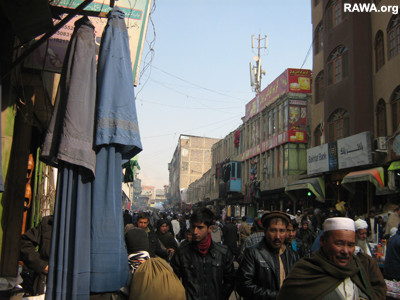 Burqas for sale in a busy market of Kabul